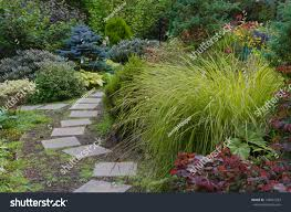 Tiled Garden Path Wends Way Through Stock Photo 146851253 ... Garden Eaging Picture Of Small Backyard Landscaping Decoration Best Elegant Front Path Ideas Uk Spectacular Designs River 25 Flagstone Path Ideas On Pinterest Lkway Define Pathyways Yard Landscape Design Ma Makeover Bbcoms House Design Housedesign Stone Outdoor Fniture Modern Diy On A Budget For How To Illuminate Your With Lighting Hgtv Garden Pea Gravel Decorative Rocks