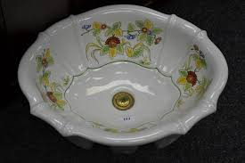 a sherle wagner italian hand painted oval sink decorated with