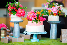 Three Wedding Cakes All Topped With Bright Fresh Flowers