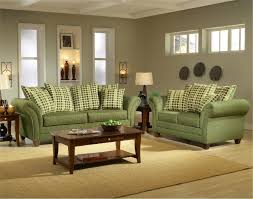 Green Fabric Sofa Plus Plaid Cream Cushions Combined With Rectangle Brown Wooden Table On The