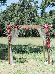 Rustic Wood Wedding Arch With Red Flowers