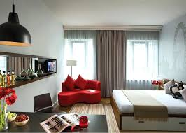 First Apartment Bedroom Ideas Captivating Red Lounge Chair Inside Modern Decorating With Wide