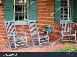 Three Green Adirondack Rocking Chairs Sit Stock Image ... Lovely Wood Rocking Chair On Front Porch Stock Photo Image Pretty Redhead Country Girl Nor Vector Exterior Background Veranda Facade Empty Archive By Category Farmhouse Hometeriordesigninfo For And Kids Room Ideas 30 Gorgeous Inviting Style Decorating New Outdoor Fniture Navy Idea Landscape Country Porch Porches Decks And Verandas Relax Traditional Southern Style Front With Rocking Vertical Color Image Of Chairs Sitting On A White Rockers The