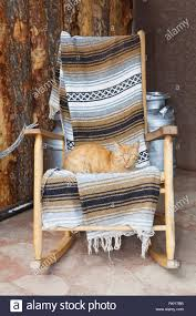 Cat On A Wooden Rocking Chair Stock Photo: 236011759 - Alamy