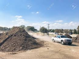 100 Sand Trucks For Sale Delivery Trucks And Giant Pile Of Compost Mulch Sand Gravel