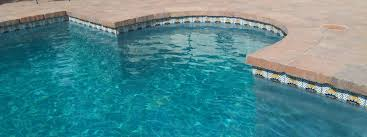 a mexican tradition graces a pool waterline accents