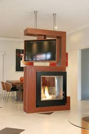 View In Gallery Awesome Room Divider Holds Turn Able TV And Two Sided Fireplace Design