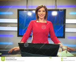 TV Reporter At The News Desk Stock Photo