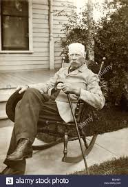 Stern Old Man In Rocking Chair On Sidewalk Stock Photo: 25314247 - Alamy Old Man Sitting In Rocking Chair And Newspaper Vector Image Vertical View Of An Old Cuban On His Veranda A A Young Is Theory Fact Ew Howe Kursi Man Rocking Chair Watching Tv Stock Royalty Free Clipart Image Collection Hickory Porch For Sale At 1stdibs Drawing Getdrawingscom For Personal Use Clipart In Art More Images The Who Falls Asleep At By Ahmet Kamil Kele Rocking Chair Genuine Old Antique Farnworth