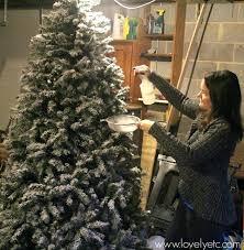 Flocking The Tree Flocked Alaskan Christmas Pre Lit Artificial