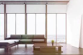 weißes wohnzimmer interio mit betonboden panoramafenster kamin ein langes graues sofa und ein schmaler couchtisch 3d rendering mock up getönten