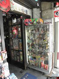 Outside Is A Grand Picture Window Crammed Full Of Vintage Toys Most Them Pretty Worn The Shop Display Case All Sorts