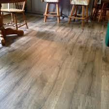 DIY Laminate Floor In Grey Room With Barstools