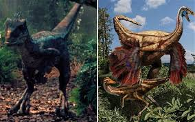 A Velociraptor From The Jurassic Park Film And An Artists Impression Of Feathered Ornithomimid Dinosaurs