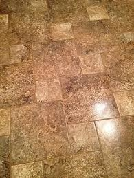 20x20 marazzi porcelain tile with a travertine medallion ta