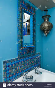 Mosaic Bathroom Mirrors Uk by Mosaic Mirror Above Sink With Moroccan Incense Burner In Renovated