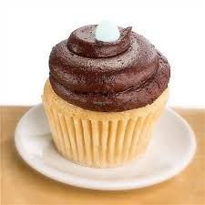 Vanilla Cake With Chocolate Frosting At Mollys Cupcakes In Des Moines