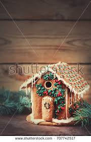 Gingerbread House On A Wooden Rustic Background Christmas Card
