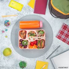 Open Lunch Box With Healthy Food On The Grey Background School Backpack