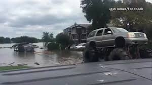 Monster Trucks Help Pull Vehicles Out Of Houston Floodwaters ...