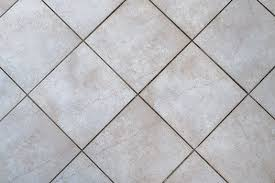 how to clean grout between tiles