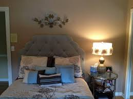 Glamorous Bedroom With Pier 1 Hayworth Upholstered Headboard And Rosette Lamp