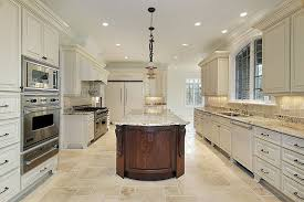 Luxury Kitchen With Antique White Cabinets And Brown Island Beige Granite