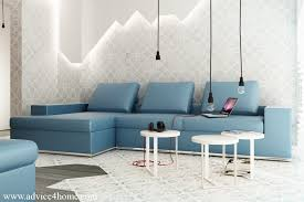 wall design and blue l shaped sofa exposed bulb lighting feature