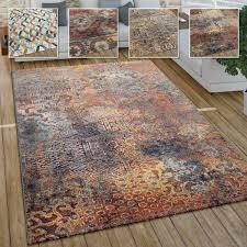 wohnzimmer teppich im vintage used look industrial style kurzflor in rostfarben