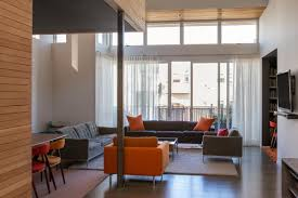 Sheer Window Treatments For A Large Loft Window Allows Light To