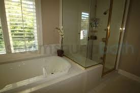 Tiling A Bathtub Deck by Tub Deck Doubles As Shower Bench Photo Gallery And Image Library