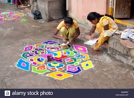 Indian Sisters Making A Rangoli Design Outside There Home During ... Best Rangoli Design Youtube Loversiq Easy For Diwali Competion Ganesh Ji Theme 50 Designs For Festivals Easy And Simple Sanskbharti Rangoli Design Sanskar Bharti How To Make Free Hand Created By Latest Home Facebook Peacock Pretty Colorful Pinterest Flower 7 Designs 2017 Sbs Your Language How Acrylic Diy Kundan Beads Art Youtube Paper Quilling Decorating