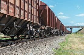 Wagons Of A Freight Train In Motion Go To Horizon Under Bridge Stock ...