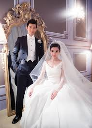 Angelababy And Huang Xiaoming Posed For Their Regal Wedding Photo