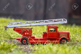 100 Metal Fire Truck Toy Old Red Engine Made Of Tin In Outdoor Setting Stock
