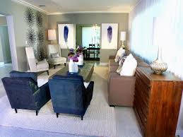 living room interior design features tufted navy blue