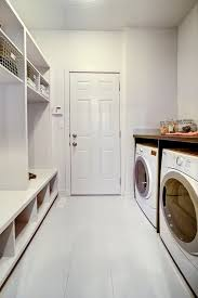 Mudroom Laundry Room Combo Features Off White Walls And Whitewashed Tile Floor