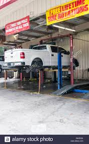 White Extended Cab Pick-up Truck Without Tires On A Lift In ... Heavy Truck Analytics Firm Said Lt Tires Led Sluggish 2017 Us Replacement Kobo Tires In Markham On Speciality Performance Light Intertional Tire Service For Sale By Carco Auto And Altons Sales Roxboro Nc Duty Commercial For Dumpconcrete Trucks How To Save Money On Maintenance Osco Tank 38565r225 396 Suv Discount Westlake Sheehan Inc Philippines Lewisville Autoplex Custom Lifted View Completed Builds Programs National Government Accounts