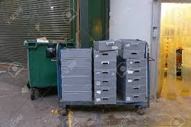 100 Steel Shipping Crates In Delivery Cart At Back Entrance