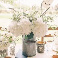 Rustic Wedding Table Decorations Milk Churns