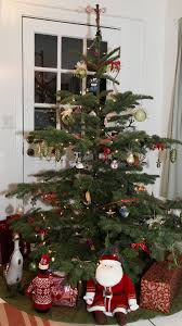 Check Out The One Of A Kind Ornaments On And Around This 6 Foot Natural Noble