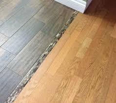 Carpet To Tile Transition Strip On Concrete by Kalb Lempereur Interiors Floor Tiles Wood White Brown Patternfloor