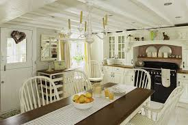 vintage country cottage kitchen three polished iron stools on
