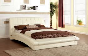 contemporary ivory padded leatherette eastern king size platform bed