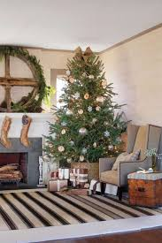 Give Your House A Refined Rustic Look By Placing Beautifully Decorated Christmas Tree In Basket The Warm Color Palette Nubby Texture And Burlap Are