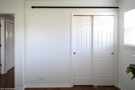 How To Build And Hang A DIY Barn Door - Step Two Of Three Bedroom Closet Barn Door Diy Cstruction How To Build Sliding Doors Custom Built Wooden Alinum Dutch Exterior Stall Epbot Make Your Own For Cheap Decor Diyawesome Interior Diy Decorations Bathroom Awesome Bathroom To A Inspired John Robinson House Ana White Cabinet For Tv Projects Build Barn Doors Tms 6ft Antique Horseshoe Wood A Howtos Let Us Show You The Hdware Do Or