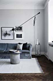 concrete floor white walls and black furniture for a modern feel