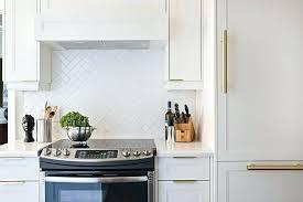 white tile backsplash glossy white herringbone kitchen tiles white
