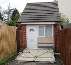 100 Garage House Couple Caught Hiding Home Behind Fake Garage Door To Get Around