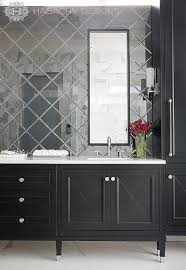 black mirrored bathroom vanity with black and white marble